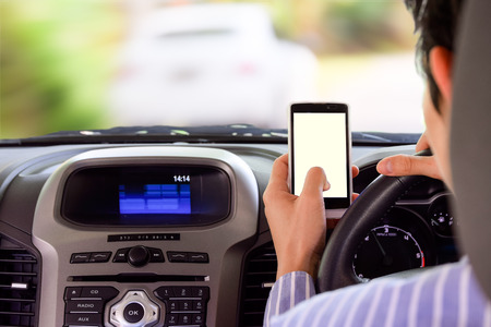 40651922 - driving while holding a mobile phone (cell phone use while driving)